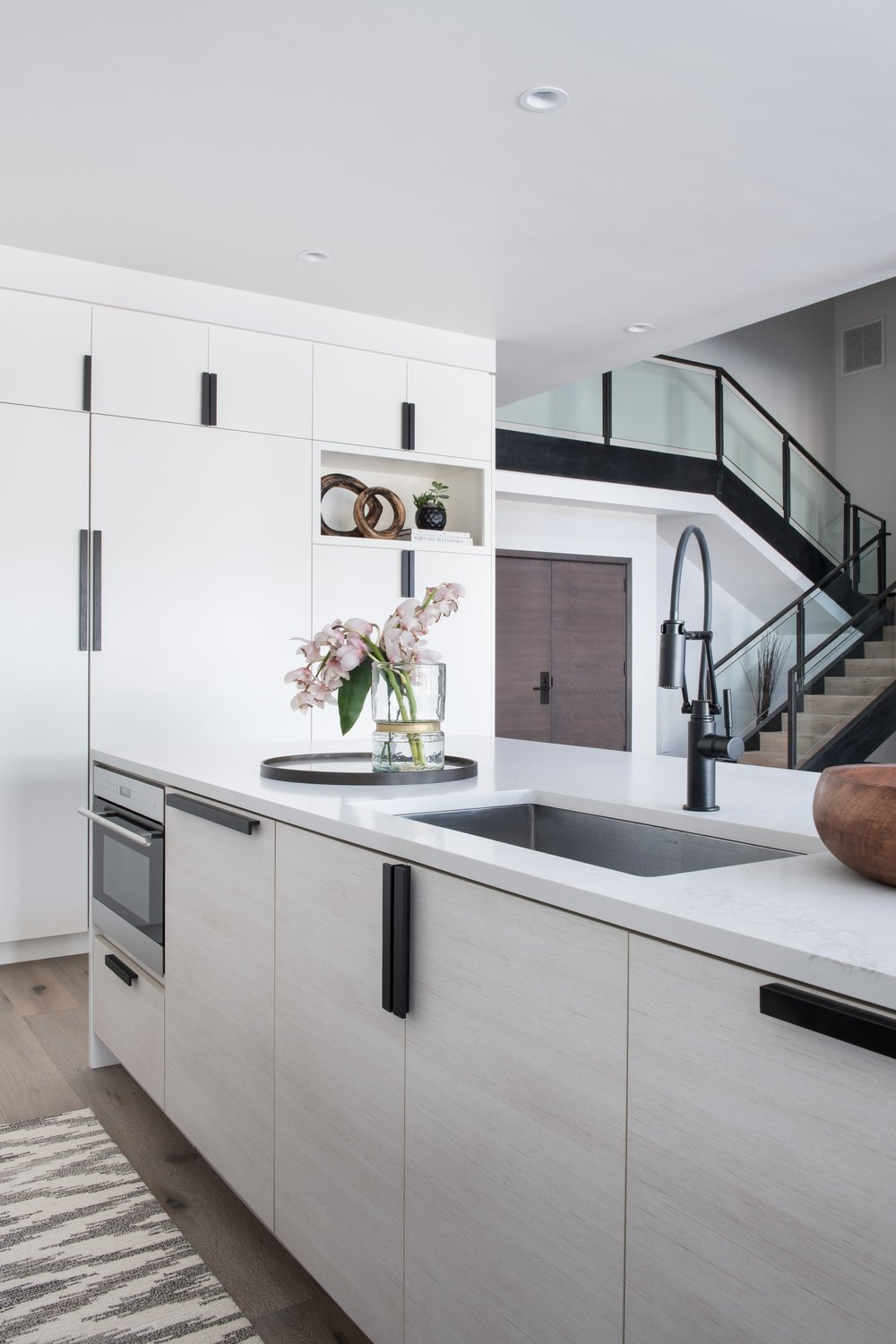 Stylish kitchen with faucet and flower vase