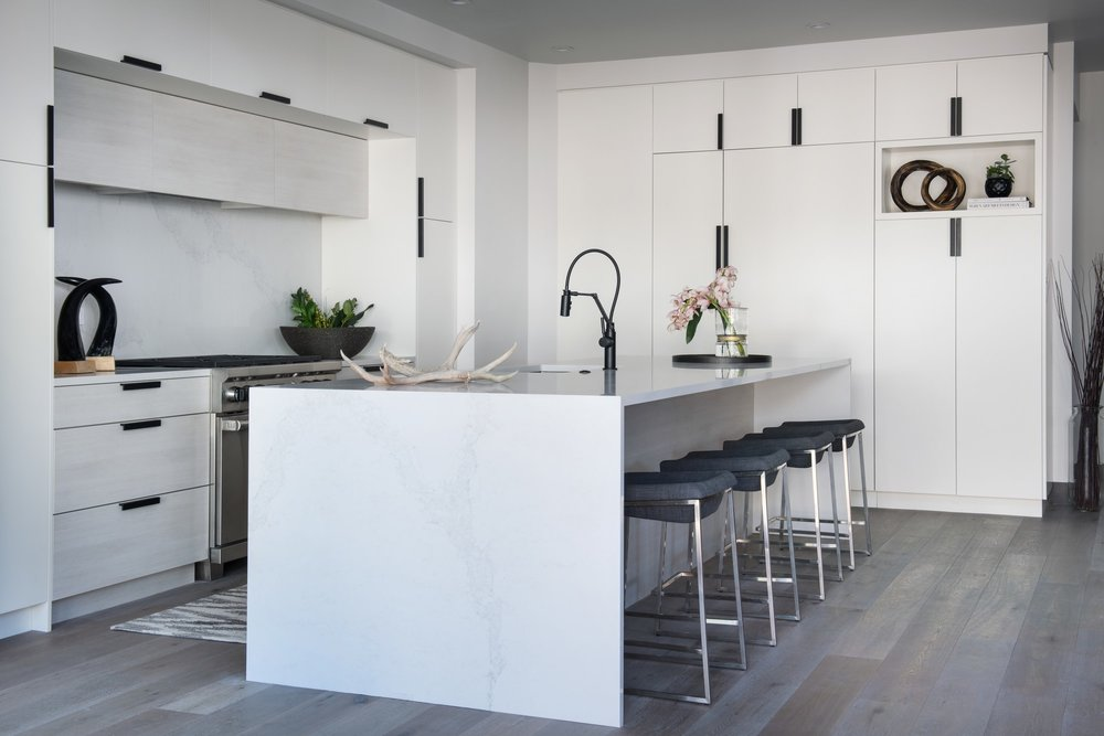 Stylish kitchen with rock wood flooring and spacious cabinet