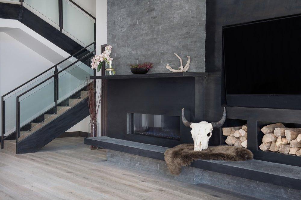Living room with flower vase beside stairway
