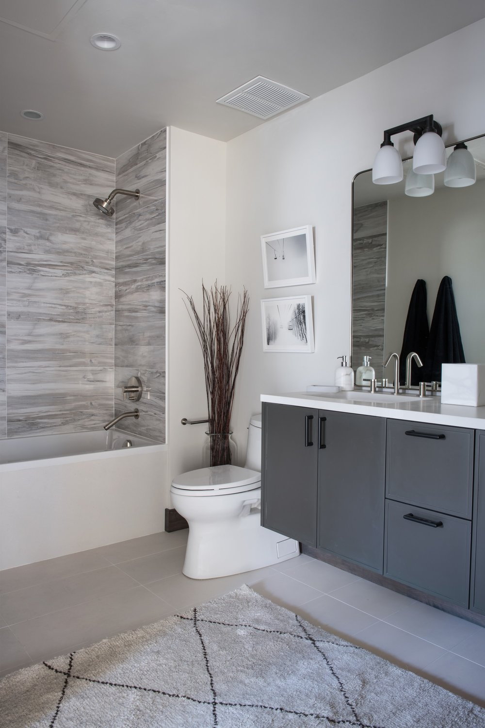 Modern bathroom with spacious cabinet and painting
