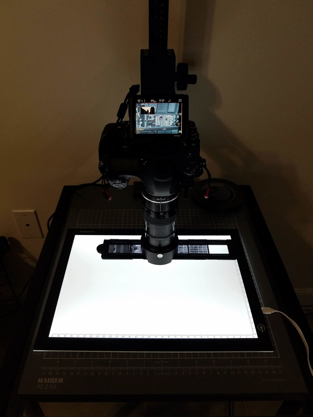 Here is the set-up I used. Basically a  copy stand  and a  light pad . You don't actually need either of these things, but I used them just because I happen to have them.