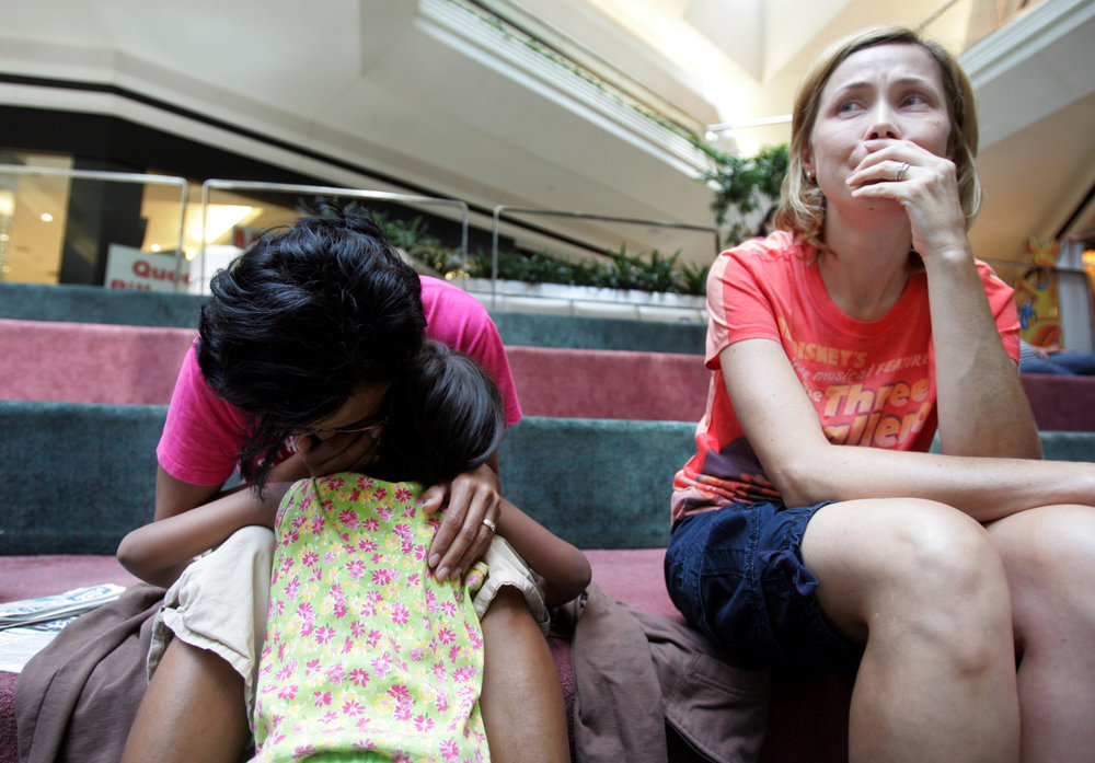 Melinda Sutton, a volunteer host for Kajal, cries as Karthi Masters meets with Kajal in a Nashville mall to tell her that she will not be able to adopt her August 7, 2007. The adoption fell apart due to conflicts between the Masters family and her guardians, the Zaidis.
