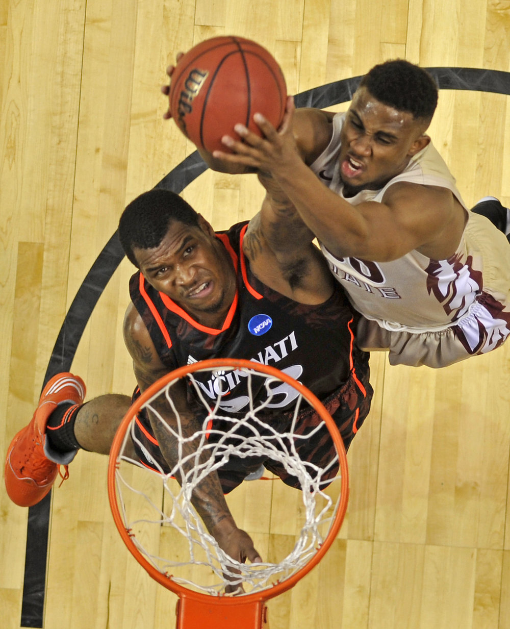 Cincinnati guard Sean Kilpatrick (23) fights for a rebound with Florida State guard Ian Miller during the first half of the NCAA Men's Third Rounds at Bridgestone Arena in Nashville, Tenn., Sunday, March 18, 2012.