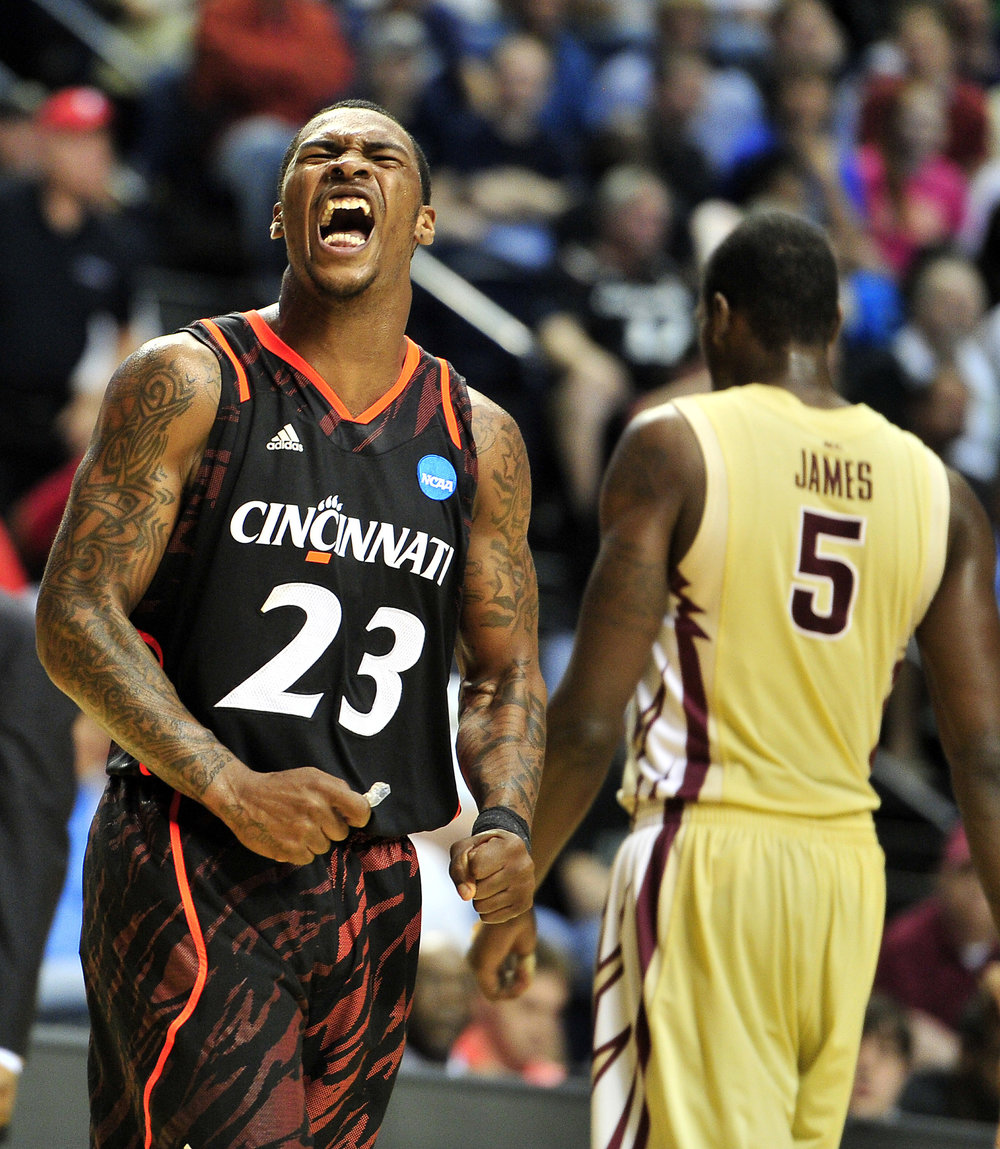 Cincinnati guard Sean Kilpatrick (23) reacts as Florida State forward Bernard James (5) walks back to the bench during the second half of Cincinnati's 62-56 win in the NCAA Men's Third Rounds at Bridgestone Arena Sunday, March 18, 2012 in Nashville, Tenn.