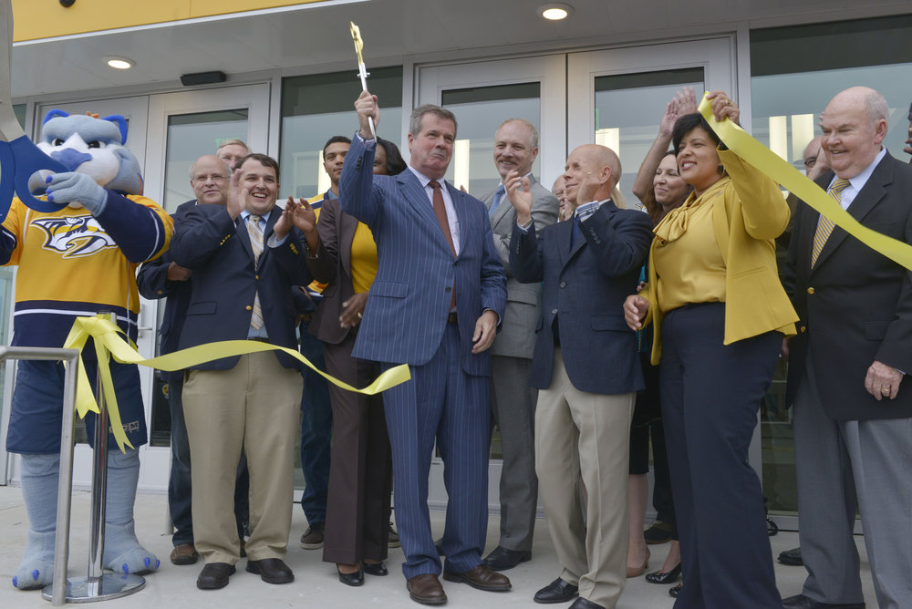 Mayor Karl Dean, the Nashville Predators, Olympian Scott Hamilton and country music superstar Vince Gill cut the ribbon for the new Ford Ice Center September 12, 2014 in Nashville, Tenn.