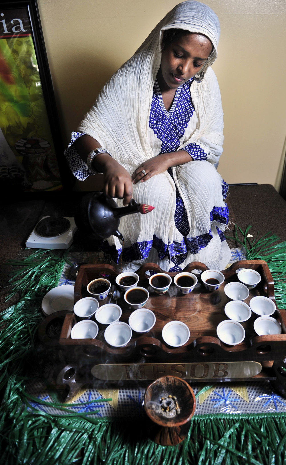 Hiwot Shafi pours out ethiopian coffee in a traditional coffee ceremony at Mesob Ethiopian Restaurant in Nashville, Tenn.