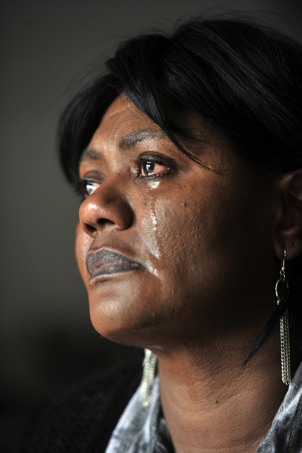 Sylvia Nolan, mother of LeRyan Nicholson, cries as she describes the years she has spent searching and waiting for her 18-year-old son April 19, 2013. Police recently confirmed that her son was a murder victim buried as a John Doe.