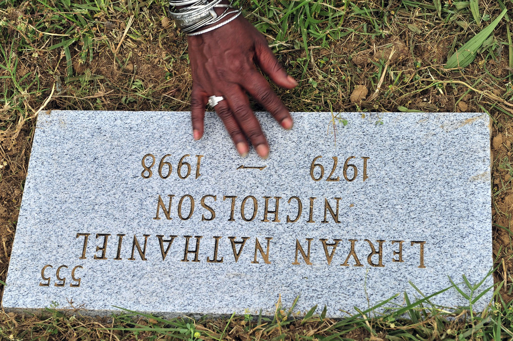 LeRyan Nicholson's gravestone is replaced at Bordeaux Cemetary May 30, 2013 in Nashville, Tenn.
