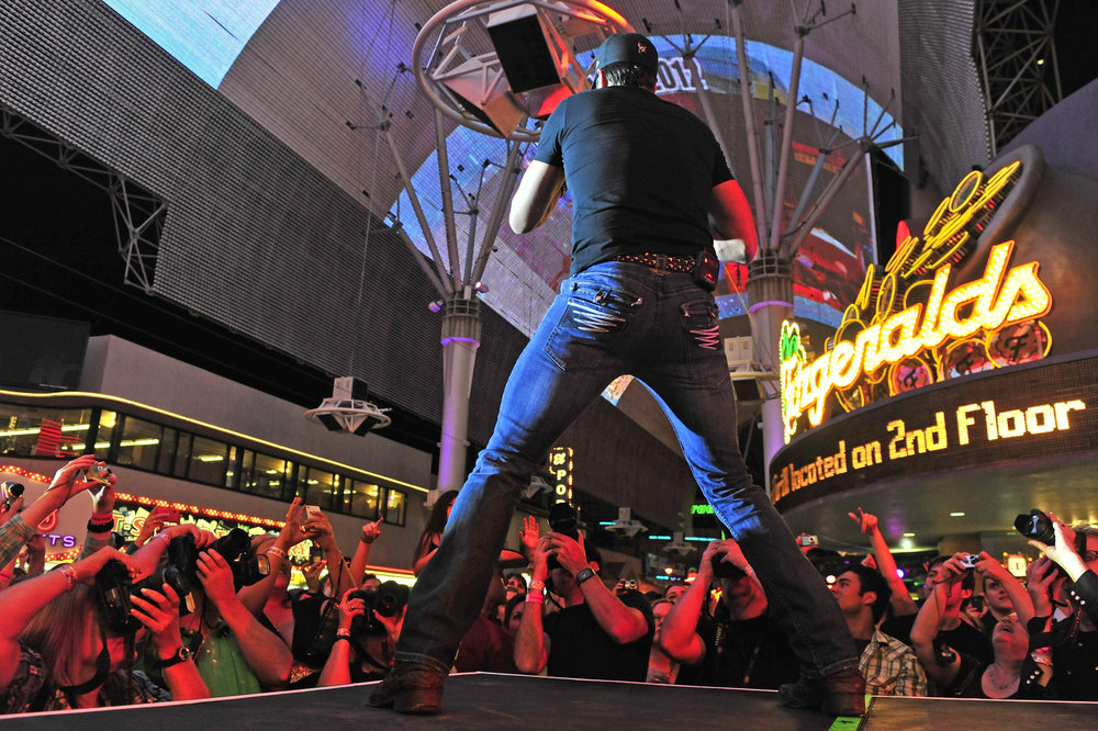 Nashville's business is music. Scenes from the industry's biggest events to its quieter moments.   Luke Bryan performs at the Fremont Street Experience, an outdoor concert in Las Vegas, during ACM week March 30, 2012 in Las Vegas, Nev.