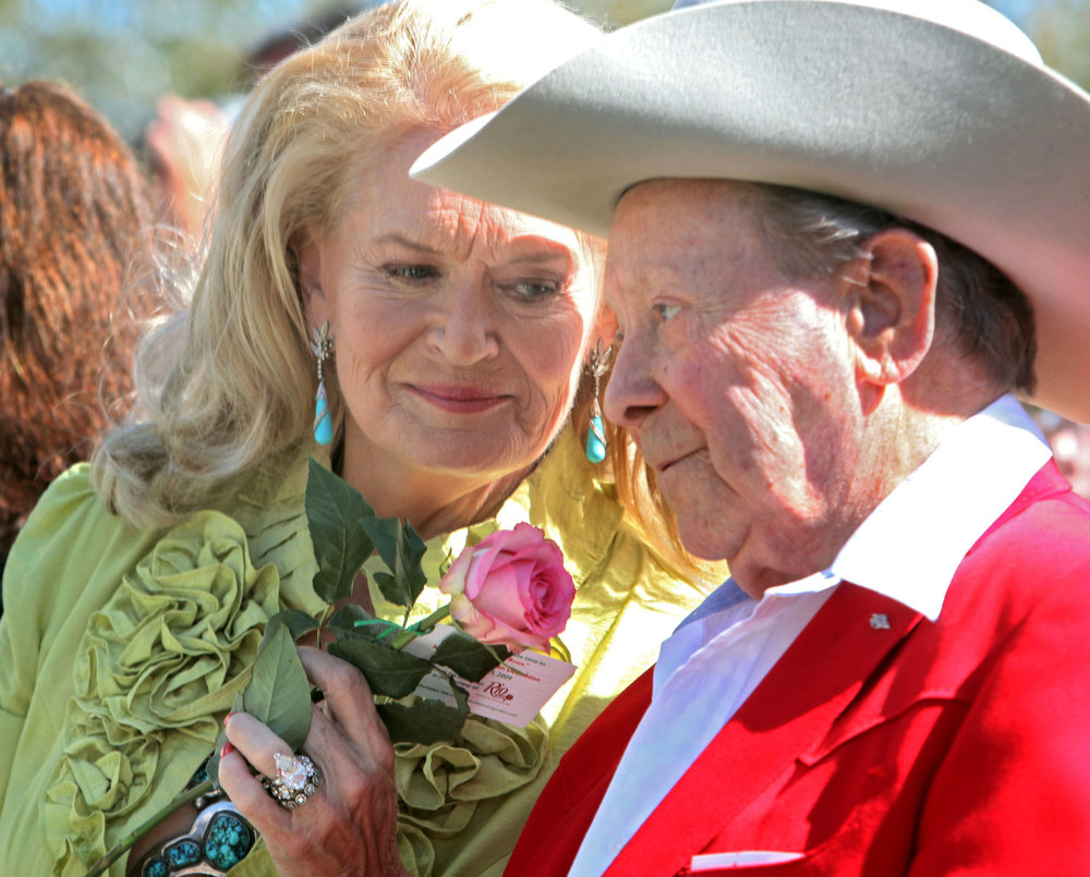 "Lynn Anderson, singer of the 1971 hit song ""(I Never Promised You A) Rose Garden"" offers Little Jimmy Dickens a rose at the dedication of the Nashville Music Garden in Hall of Fame Park Tuesday, September 29, 2009 in Nashville, Tenn."