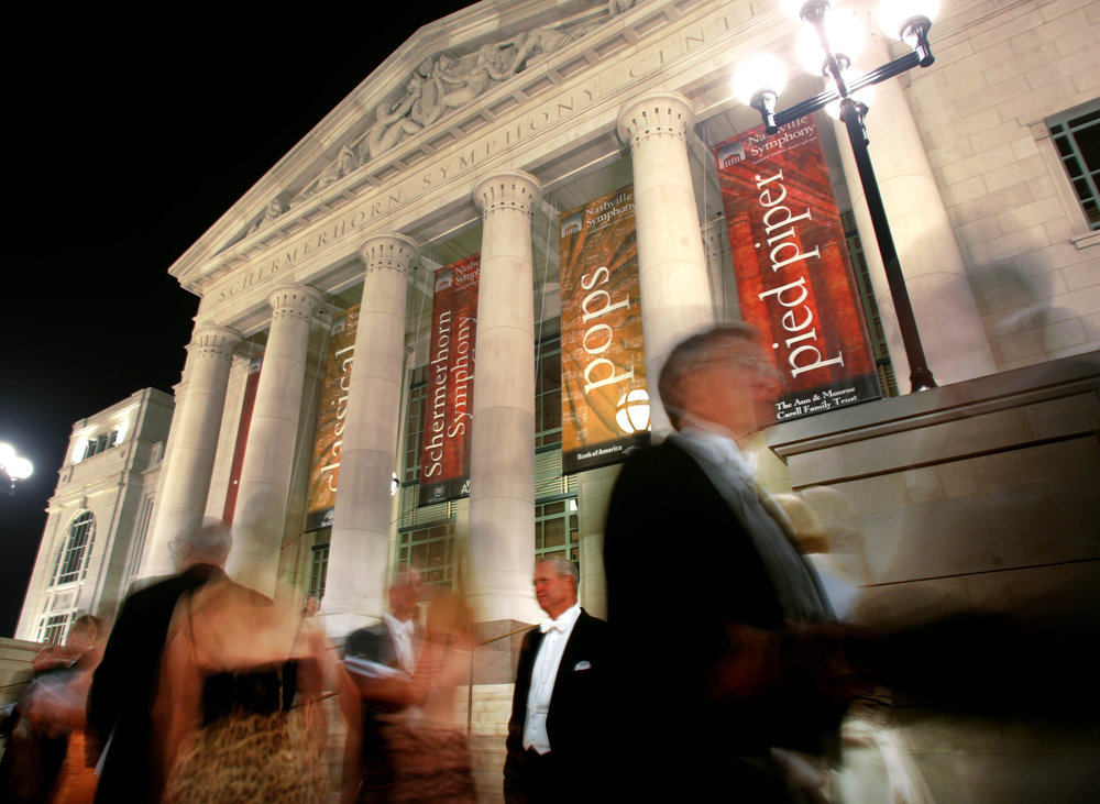 Symphony-goers stand outside the Symphony Center in the evening during the black-tie opening gala Saturday, September 9, 2006 in Nashville, Tenn.