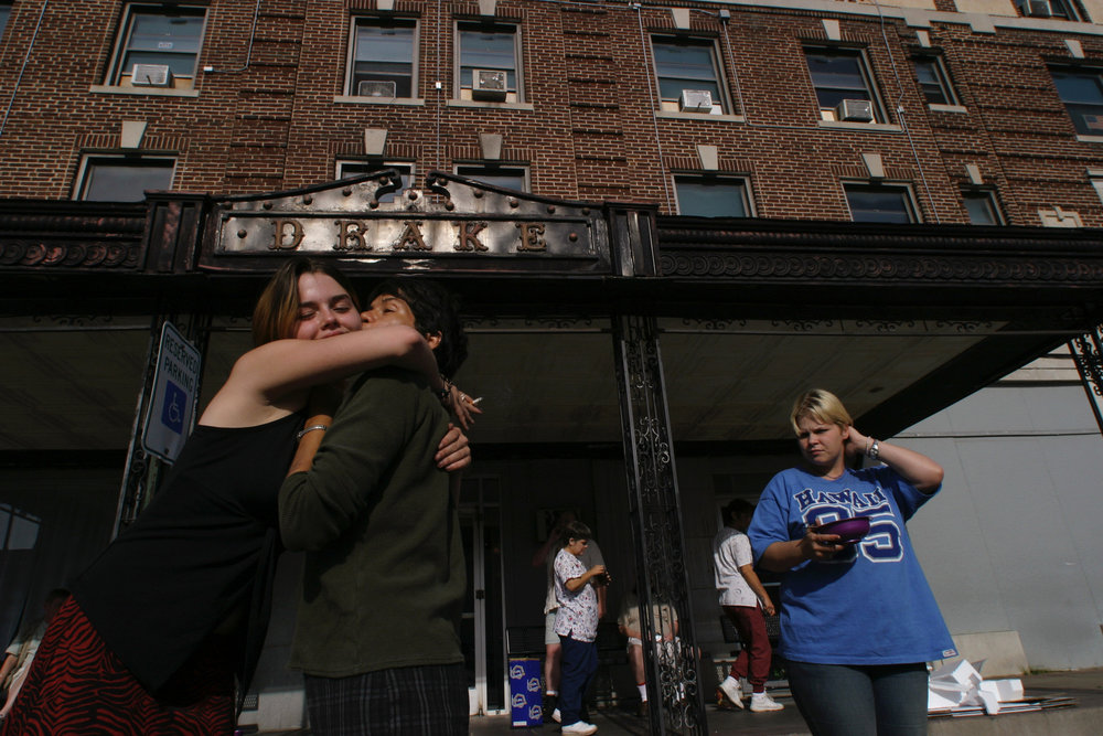 Keesha Gilleland , 16, hugs Toni, at the Drake guesthouse, formerly an upscale hotel in downtown Carthage, Missouri, now a group home for the mentally and physically disabled.