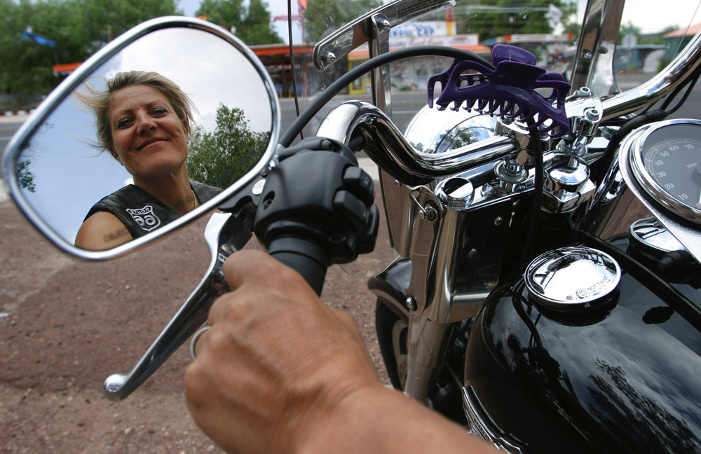 Gabrielle Ritzy of Switzerland, on her Harley Davidson in Seligman, Arizona. Ritzy is one of the many Europeans who travel to the U.S to ride Route 66.