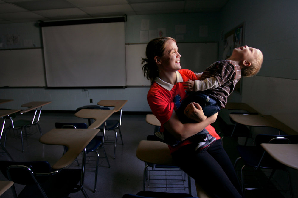 Graduating senior Amelia Koon with her son Christopher, 1, at Hunters Lane High School in Nashville, Tenn. Koon doubled up her coursework after missing a year and hopes to go to college.