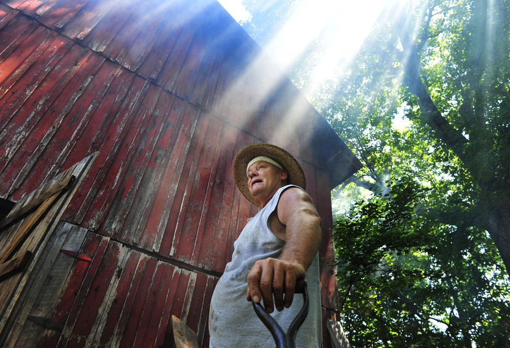 John Goff, 53, outside a tobacco barn during the firing process on his farm in Coopertown, Tenn. Robertson County is of the primary producers of dark-fired tobacco in the nation.