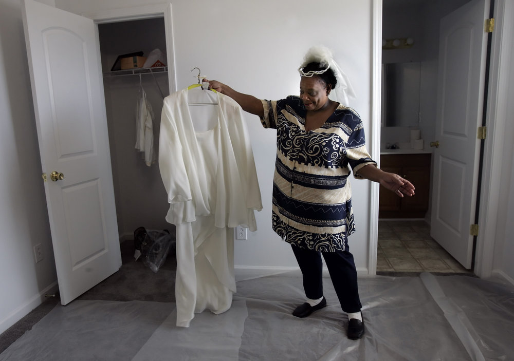 Phyllis Palmer shows off her wedding dress in her new habitat house  in Nashville, Tenn. Palmer and George Shaw, who was displaced by Katrina, will be married Sunday afternoon at the Habitat for Humanity's Timberwood subdivision site.