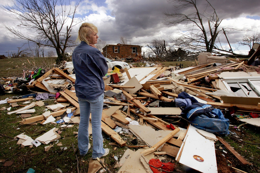 Sherry Givens stands in the wreckage of a tornado touchdown February 8 2008 in Lafayette, Tenn.