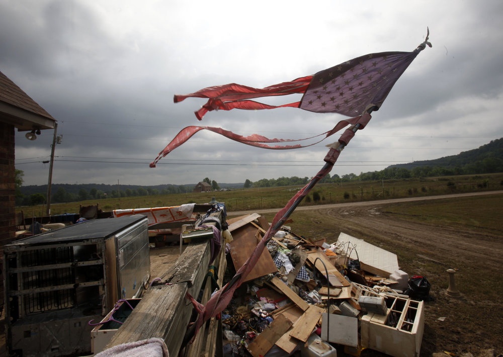 A flag is in tatters amidst wreckage after the historic 2010 flood inundated this floodplain along the Cumberland near Ashland City Wednesday, May 12, 2010 in Cheatham County, Tenn.