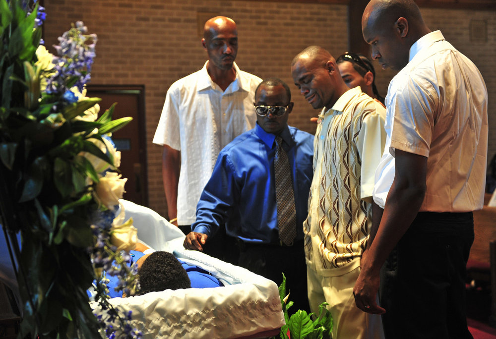 Mourners at the casket of murder victim Larry E. King during his memorial service August 27, 2011 in Nashville, Tenn. King's killer was out of prison on early release parole.