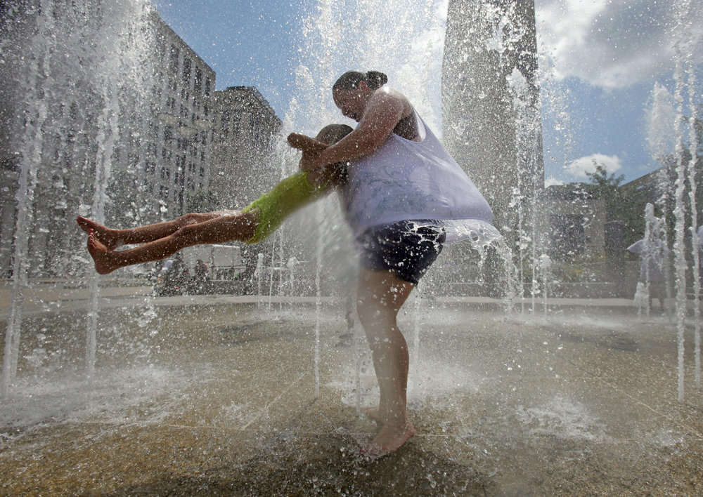 Kimberly Beard plays with Ava Covell, 5, at the fountains in Public Square Monday, July 19, 2010 in Nashville, Tenn.