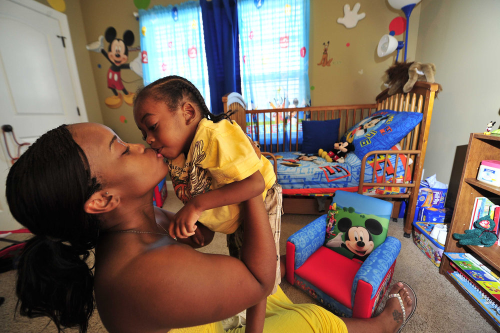 LaKesha Welch kisses son Darian Jones, 4, in his Mickey Mouse themed bedroom at home July 20, 2011 in Nashville, Tenn. Her son has suffered from an unknown diseases since he was one years old that is robbing him of motor skills and speech.