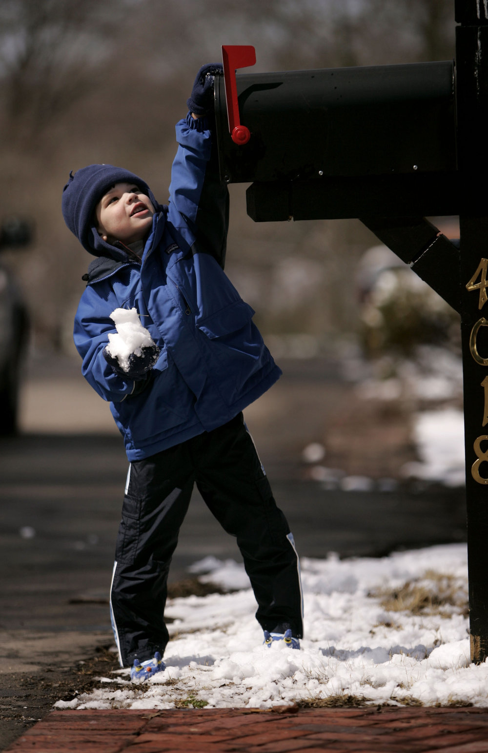 Chase Fields, 3, puts a snowball in a mailbox Saturday morning as several inches of snowfall began melting quickly Saturday, March 8, 2008 in Nashville, Tenn.