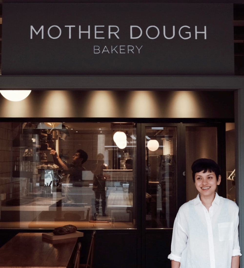 Naadhira / Head Baker - Born from a deep-seated love for baking and breaking bread, Mother Dough Bakery was founded in May 2018 by head baker, Naadhira Ismail. She started her bread and pastry journey in 2012 at the International Culinary Institute in New York and spent the next four years in the city working at various bakeries and restaurants. But it wasn't till she started her stint at Runner & Stone where her love for the craft deepened. She tasted one of the best baguettes in this Brooklyn bakery and carried on to study the intricate process and rhythms of slow fermentation.Mother Dough refers to the fermentation starter or sourdough culture used in bread making; an essential ingredient that characterises a bread. Theirs came all the way from New York and once resided in a tiny kitchen of a beloved Brooklyn bakery. She now sits in North Bridge Road, absorbing the local atmosphere and reinventing herself. She is the basis of all their pastries and naturally leavened breads, giving rise to complex flavours, textures and nutritional value. Handcrafted with artisanal technique with an emphasis placed on flavour and quality ingredients, everything at Mother Dough is baked daily.Naadhira's favourite way to start the day is having fresh baguette with honey, and dunking croissant into coffee. And backing her up, is a pretty awesome team.