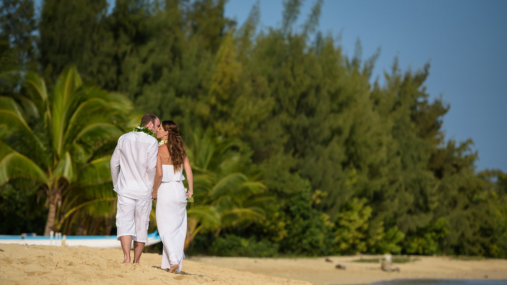 An intimate destination wedding at Kualoa Ranch Secret Island, Hawaii.