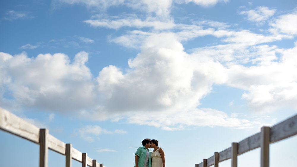 A kiss in the clouds on a little wooden bridge. Waimanalo, Hawaii