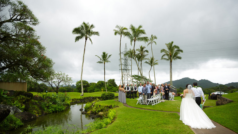Father walking his daughter down the aisle at Koolau Ballrooms Outdoor Garden in Hawaii.