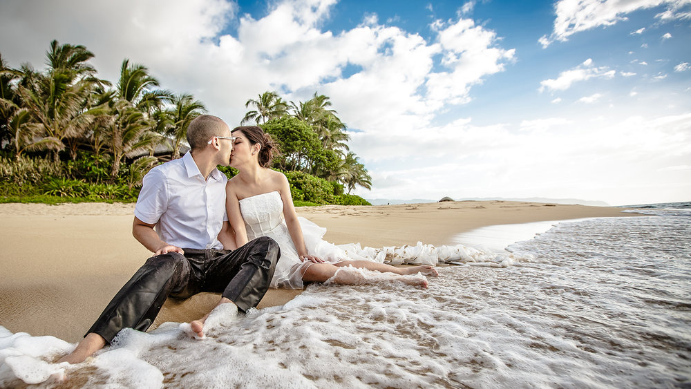 A post wedding session kiss on the beach on the North Shore of Hawaii.