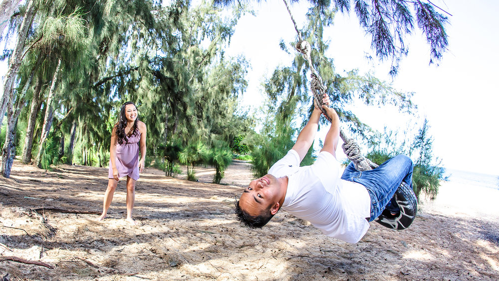A little fun on the tire swing during their engagement session on the North Shore of Hawaii.