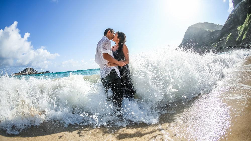 A kiss on the shoreline at Makapuu beach, Hawaii.