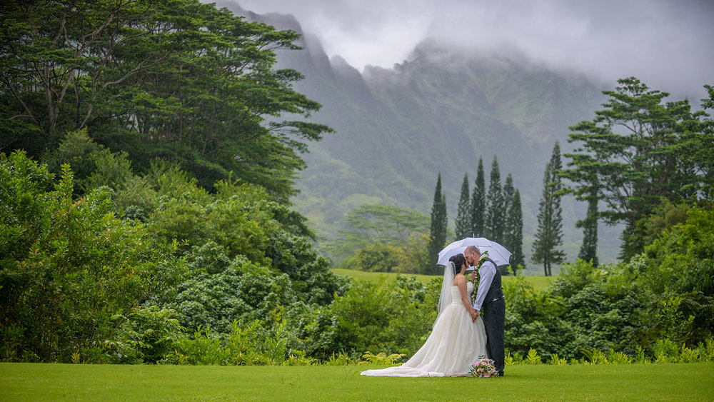 A couple's session with the majestic Koolau mountains in the background at the Koolau ballroom in Hawaii.