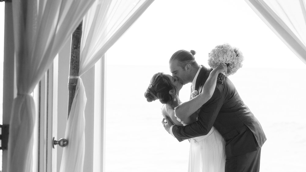 The bride and groom's first kiss at the Turtle Bay Resort in Kahuku, Hawaii on the North Shore.