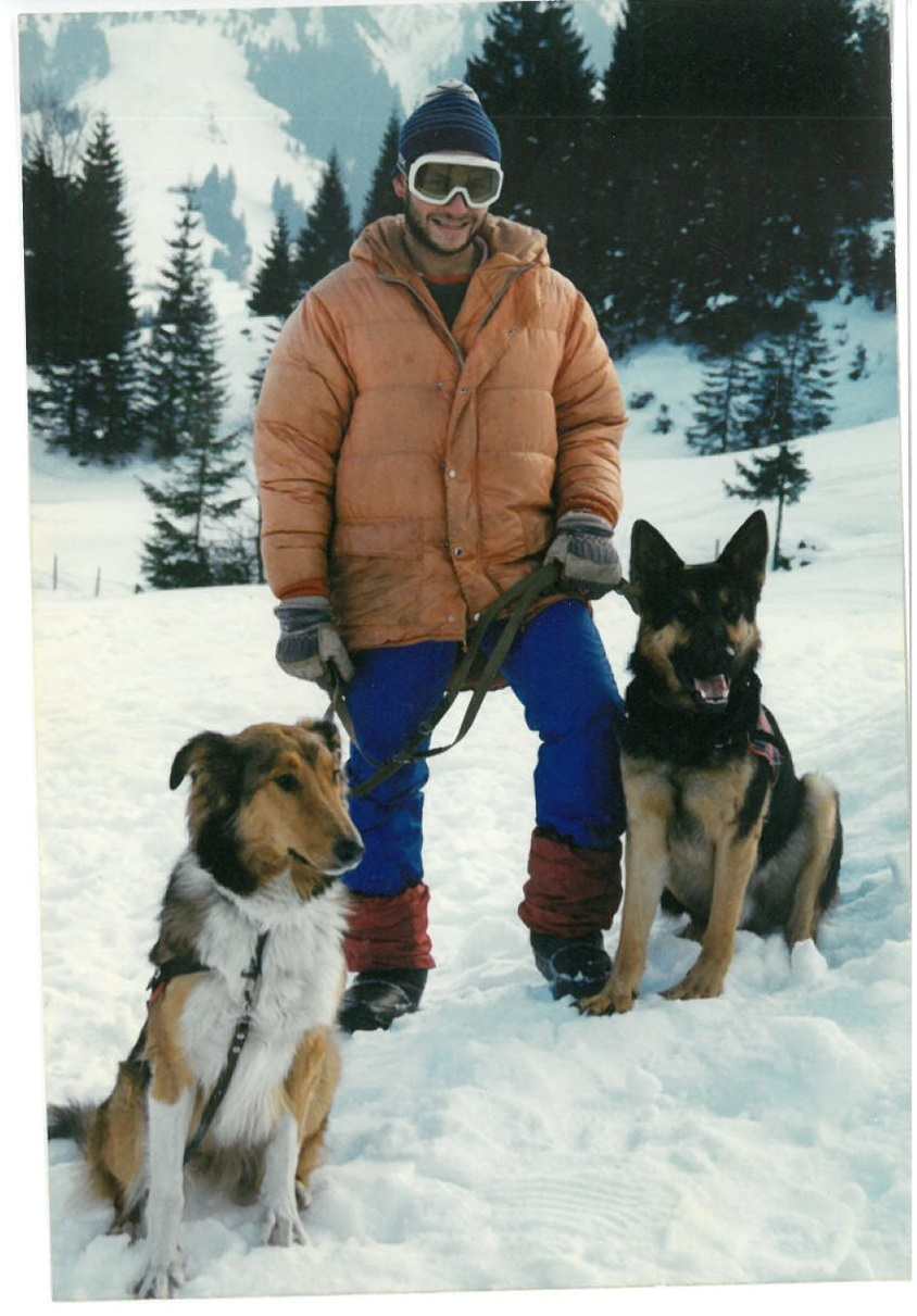 Young Vahagn with rescue dogs Yuron and Collie.