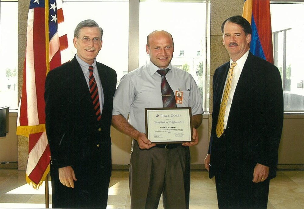 Vahagn receiving an award from the U.S. Embassy after joining Peace Corps.