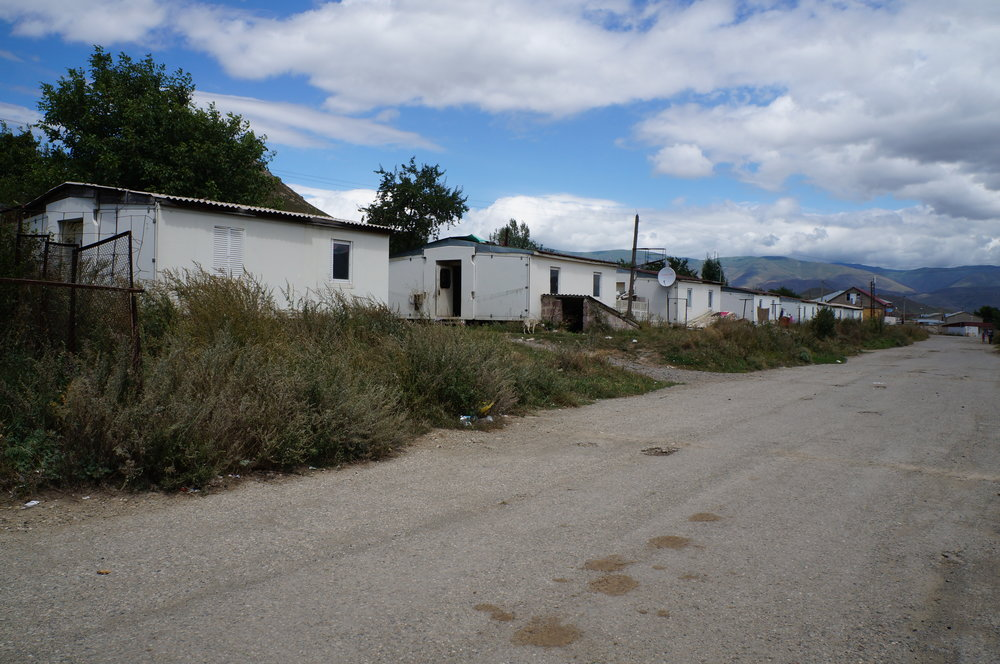 A line of Italian-constructed domiks (small, temporary houses) where families still live in Spitak.