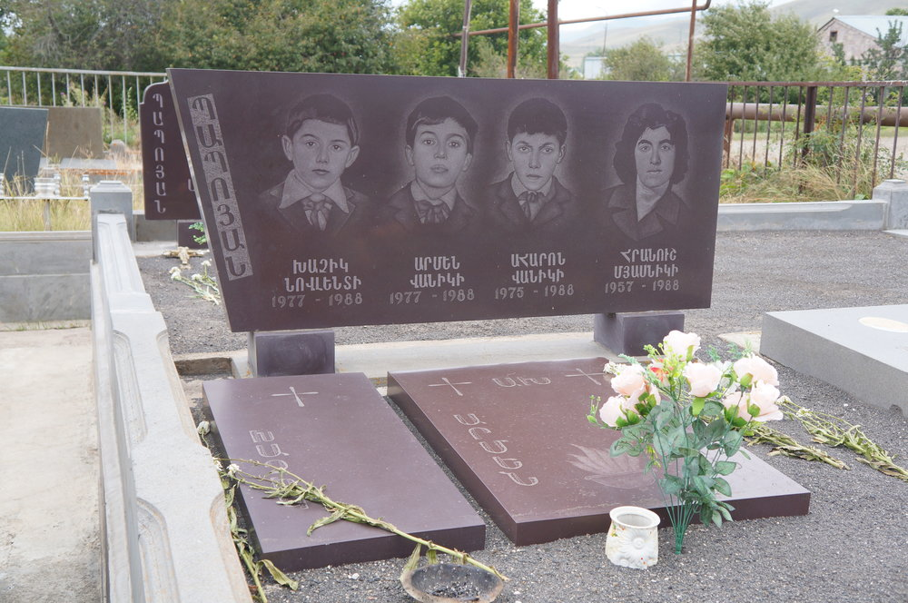 Gravestones for schoolchildren who died together in the earthquake.