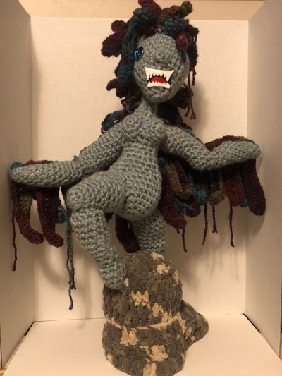 """Past Satellite Artist News - We welcome Jessica Higo Walbridge as our Satellite Artist. Jess is not in residence at YAH, but on our website and social media. She is a master crocheter whose intention is """"to bring 'women's work' into a fine art setting"""" with her references to monster and powerful women. She has made her body of work by morphing classical concepts, feminist undertones, and monstrous themes into unexpected fiber pieces.Be sure to check our What's New tab to see what Jess is working on for our January gallery exhibition."""
