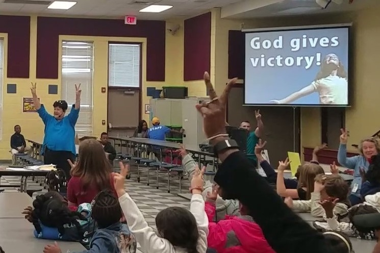 Volunteer of Halcyon Baptist Church teaches children about God's character during a Bible Lesson at the Halcyon Elementary  Good News Club®