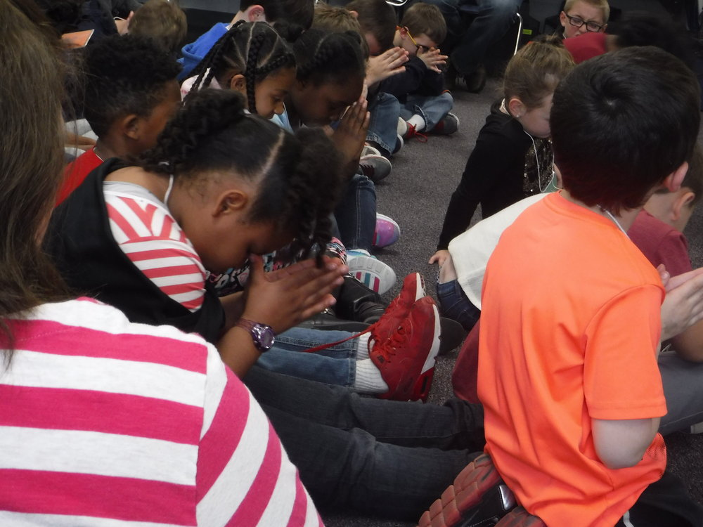 Students learn to pray at the Coosada Elementary  Good News Club® .