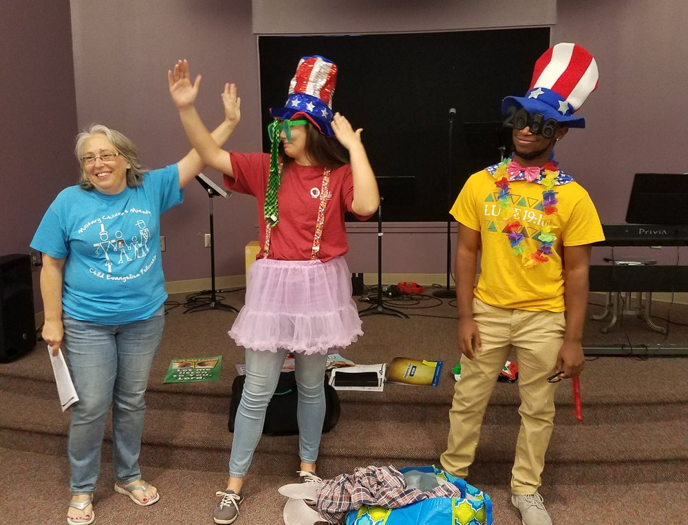 Teree Solomon, with Abby Solomon and Isaac Ritchie, lead a demonstration of  5-Day Club®  for a Summer Church Partner Training.