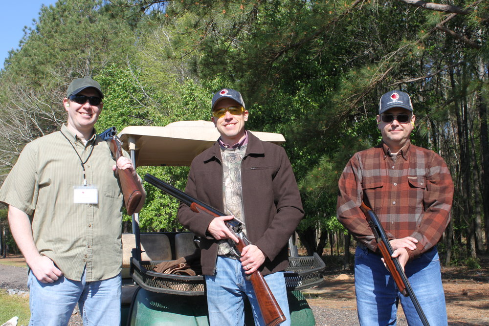 Evan Brown (left) participates with his team at the Good News Clay Shoot to benefit  CEF®  of Central Alabama Summer Missions.