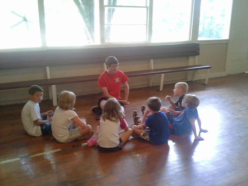 Andy Russell counsels children after a Bible lesson at a Camp Grandview  5-Day Club®  in Wetumpka, Alabama.