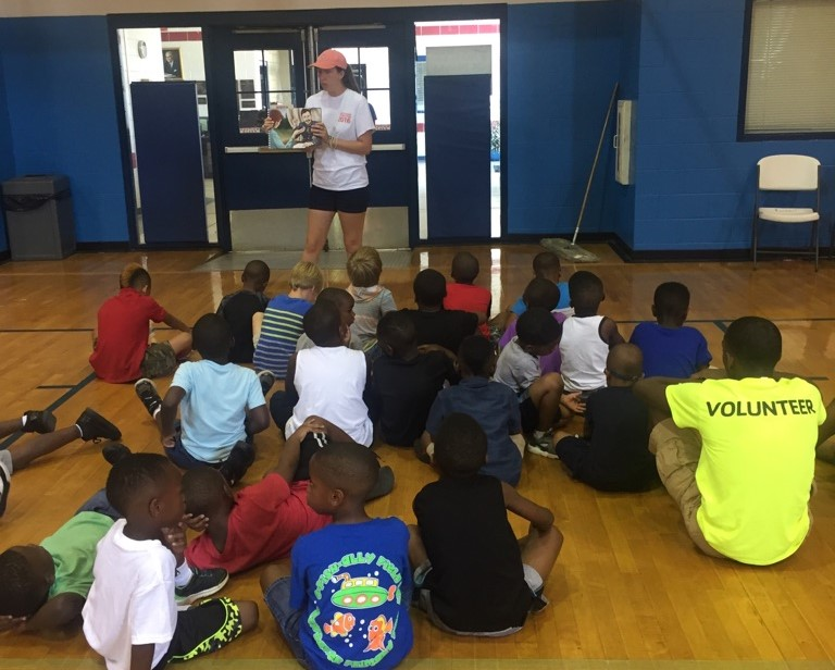 Emily Burkhalter, intern from Young Meadows Presbyterian Church, teaches the story of Mary Slessor, missionary to what is now Nigeria, to children in  5-Day Club®  at the Kershaw YMCA in Montgomery Alabama.