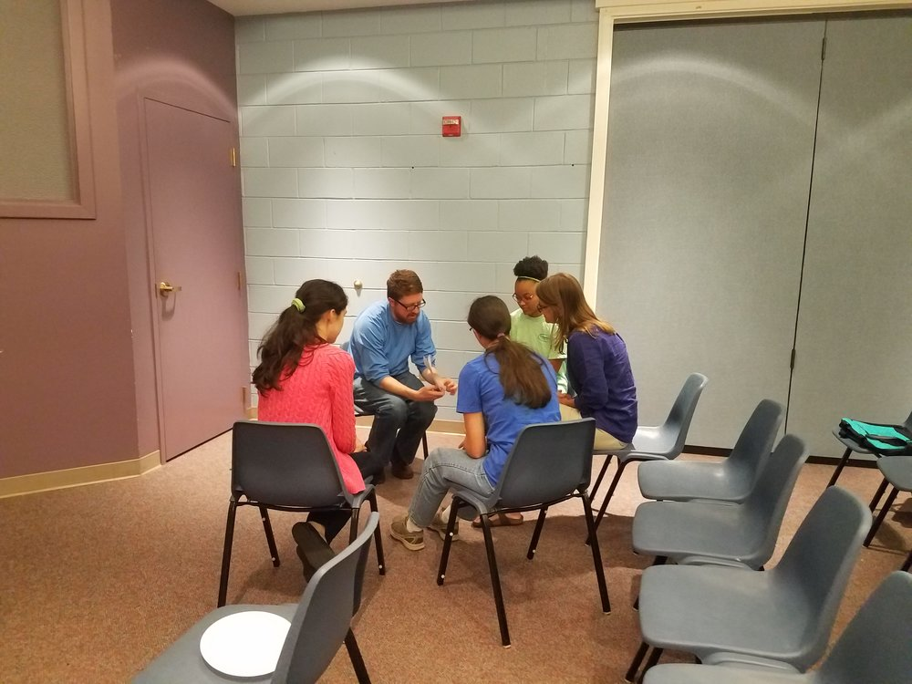 Adam Coppock, of Young Meadows Presbyterian, leads his Summer Mission team in prayer at the Summer Church Training in partnership with  CEF®  of Central Alabama. .