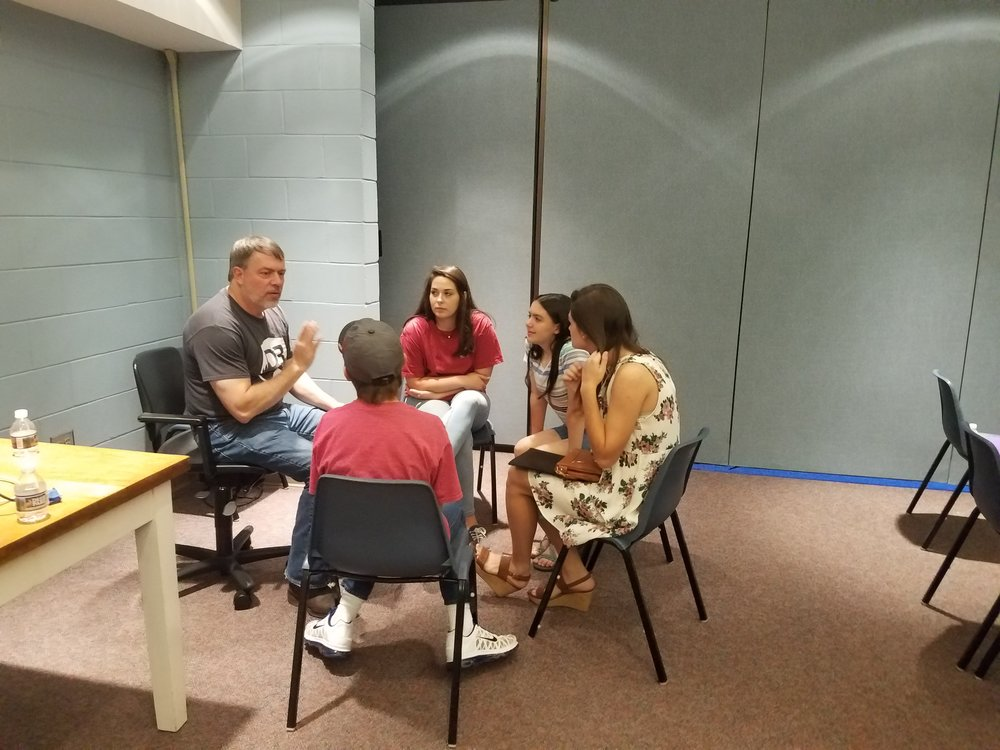 Reid Ward of Morningview Baptist Church leads his team in prayer at the Summer Church Training as part of a partnership between Morningview Baptist Church and  CEF®  of Central Alabama.