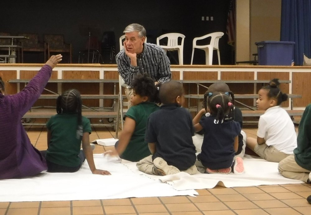 Bill Thompson, pastor of Grace Presbyterian Church, teaches a Bible lesson about the Holy Spirit at the Dozier Elementary  Good News Club® .
