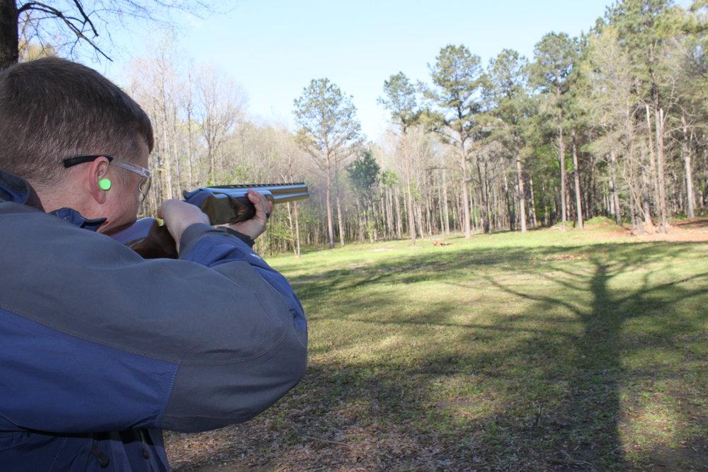 Participant takes aim.